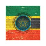 Guitarra acústica vieja con la bandera etíope impresion en lona