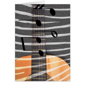 Guitarra del estampado de zebra con las notas tarjeta