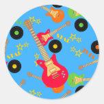 Guitarra roja eléctrica etiqueta redonda