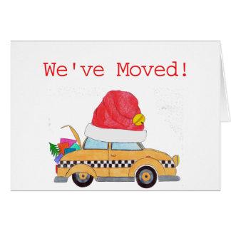Hemos movido el taxi amarillo del navidad tarjeta de felicitación