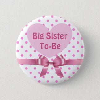 Hermana grande del lunar rosado a ser botón de la