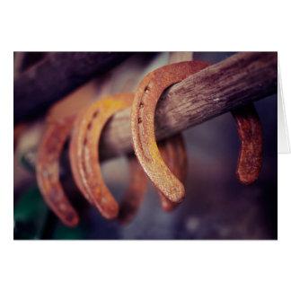 Herraduras en el país de madera del vaquero del tarjeta pequeña
