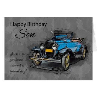 Hijo, coche azul del vintage en fondo de la tarjeta de felicitación