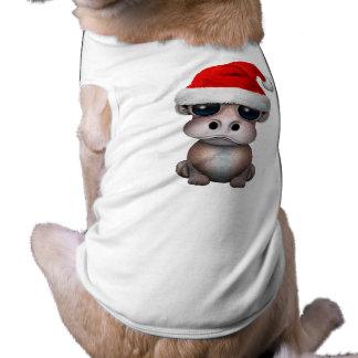 Hipopótamo del bebé que lleva un gorra de Santa
