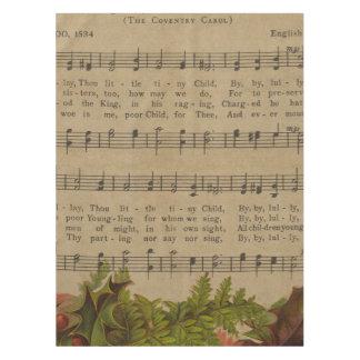 Hoja de música del villancico del navidad del mantel