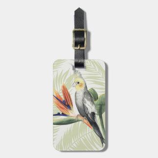 Hojas de palma con el pájaro negro etiqueta para maletas