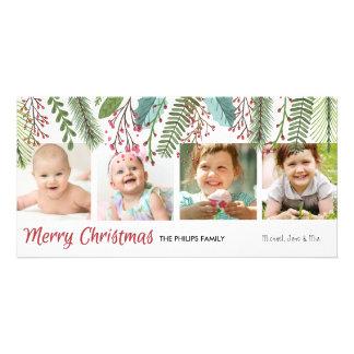 Hojas del navidad en tarjeta de la foto del