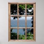 Hojas y opinión del mar de una ventana poster