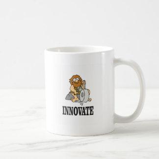 hombre de las cavernas de la innovación taza de café