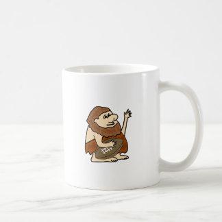 Hombre de las cavernas divertido con el dibujo taza de café