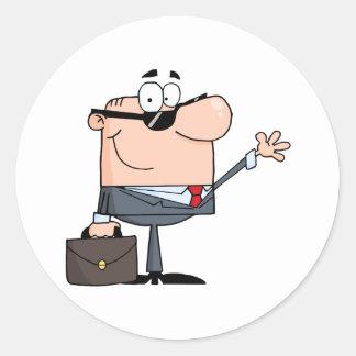 Hombre de negocios amistoso que agita un saludo pegatina redonda