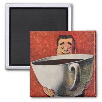 Hombre feliz del vintage que bebe la taza de café imán