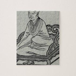Hombre que se sienta en actitud de la meditación puzzle