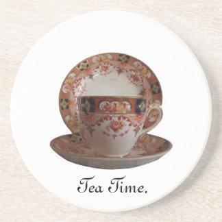 Hora para el práctico de costa del té posavaso para bebida