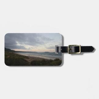 Horizonte de la etiqueta del equipaje de la playa