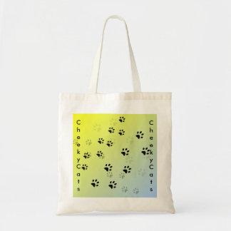 Huellas frescas del gato con el fondo amarillo bolsa tela barata