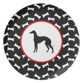 Hueso de perro blanco y negro de la silueta del plato para fiesta