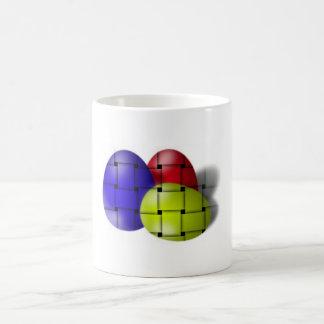 Huevos brillantes tejidos simplistas para la taza