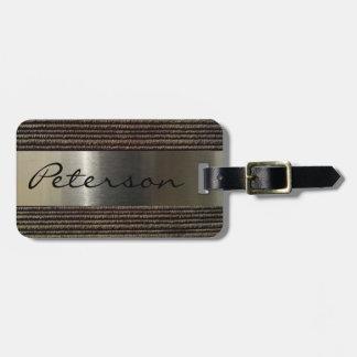 Imagen gris de la pana y del acero de los hombres etiqueta para maletas