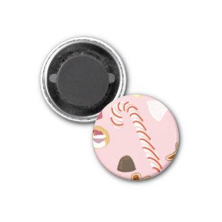 Imán Bastones y chocolates de caramelo en rosa
