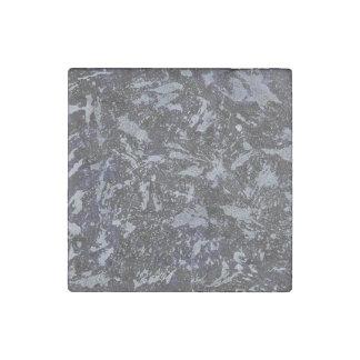 Imán De Piedra Tinta blanco y negro en fondo púrpura