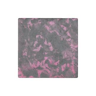Imán De Piedra Tinta negra en fondo rosado