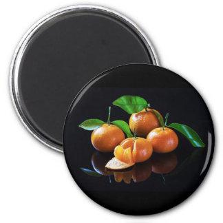 Imán Mandarinas en un fondo negro