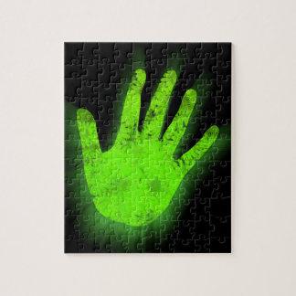 Impresión de la mano que brilla intensamente puzzle