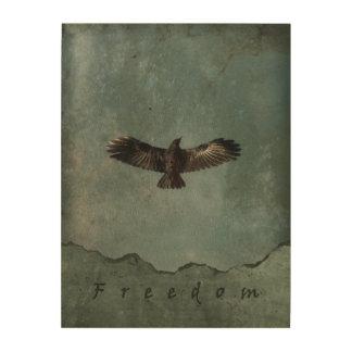 Impresión En Madera Un cuervo en vuelo en el fondo verde y gris de