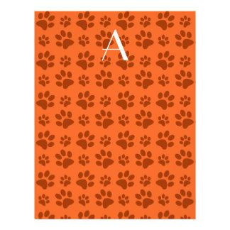 Impresiones anaranjadas de la pata del perro del m tarjetas informativas