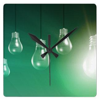Innovación creativa y concepto que brilla reloj cuadrado