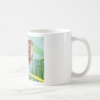 insecto bonito de la imagen del moreno del marrón taza de café