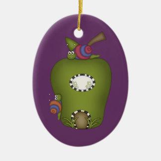 Insectos y fruta adorno ovalado de cerámica