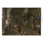Interior de la cocina con dos criadas que preparan tarjeta