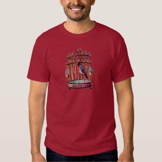 Jaula de pájaros cortada con tintas pedazo del camiseta