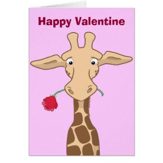 Jirafa con una tarjeta color de rosa de la tarjeta