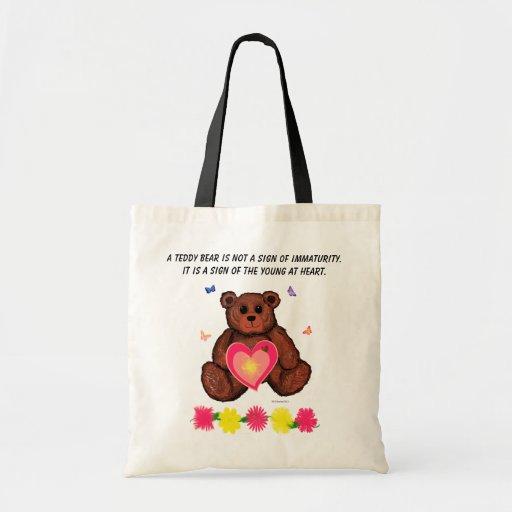 Jóvenes del oso de peluche en el tote del presupue bolsas de mano