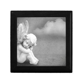 Joyero Ángel el dormir en el fondo gris, arte angelical