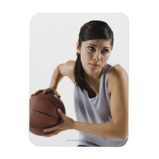 Jugador de básquet de sexo femenino iman rectangular