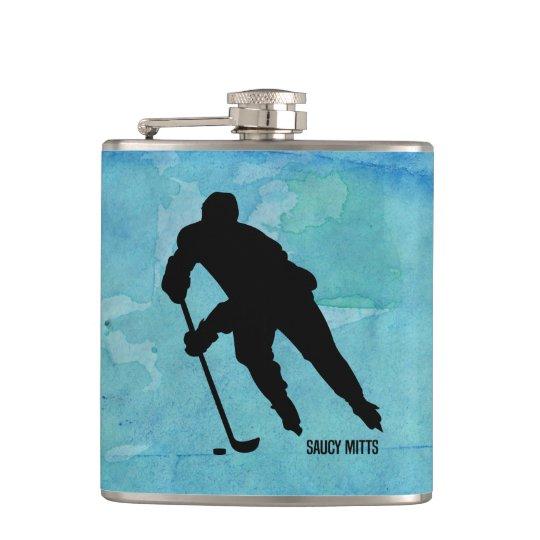 Jugador de hockey en acuarela azul petaca