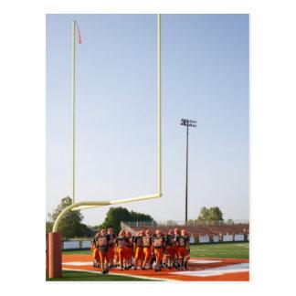 Jugadores de fútbol americano, incluyendo adolesce tarjetas postales
