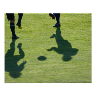Jugadores de fútbol que hacen los taladros impresiones