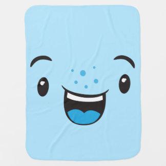 Kawaii sonriente azul hace frente a la manta del