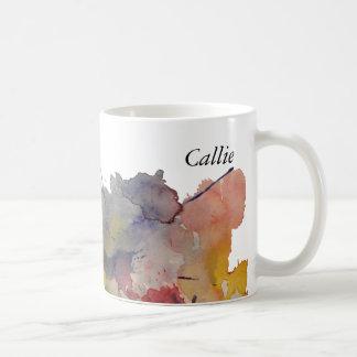 La acuarela del color primario salpica, taza de café