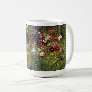 La amapola del prado florece la taza floral