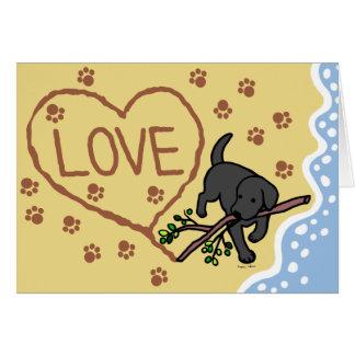 La arena negra de Labrador pone letras a tarjetas