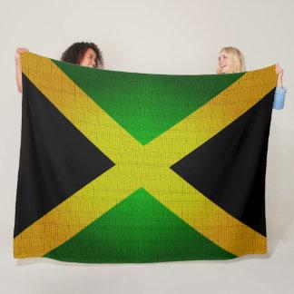 La bandera de Jamaica colorea la manta del