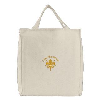 La bolsa de asas adaptable de la flor de lis