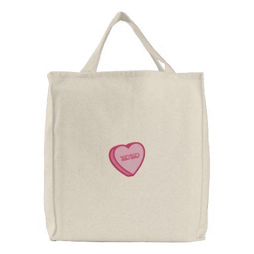 La bolsa de asas adorable del corazón de la tarjet