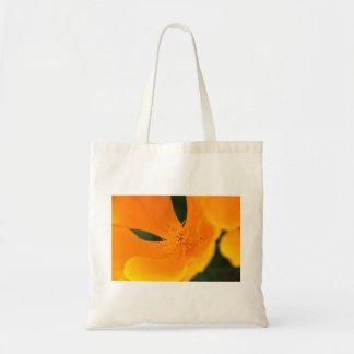 La bolsa de asas anaranjada de la flor
